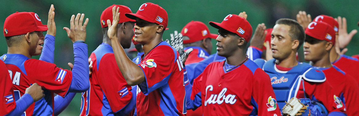 Cuba's players celebrate after defeating Brazil in their WBC qualifying first round game in Fukuoka